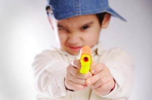 Boy with toy gun (PRNewsFoto/American Academy of Ophthalmo...)
